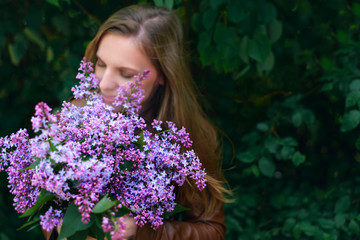 girl holding a bouquet of lilacs.