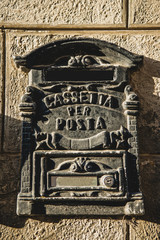 post sign on wall in Orvieto, Rome suburb, Italy