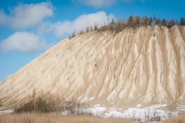 Slag heap background texture. Geological and industrial district. Winter season. Rummu, Estonia.
