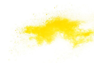 Freeze motion of yellow powder explosions isolated on white background