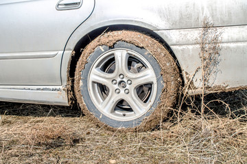 Wheel of a car in the mud