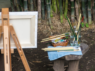 Paintbrushes and other artist equipment on wooden table