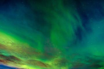 A beautiful green Aurora borealis or northern lights, Norway