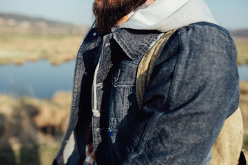 man in a denim with a backpack