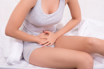 Young women have menstrual cramps.