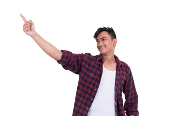 Asian handsome guy is pointing at something. On a white background