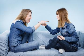 Two women friends having weird conversation