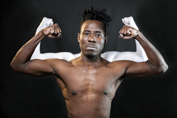 black man shows muscles against white hands