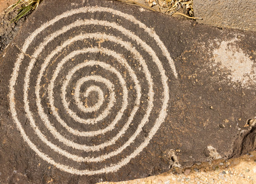 Spiral circle of life petroglyph. Ancient Pueblo etching located at Petroglyph National Monument, Albuquerque, New Mexico.