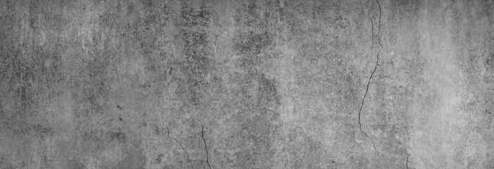 Dunkelgraue glatte Betontextur mit charaktergebenden Rissen in XXL als Hintergrund