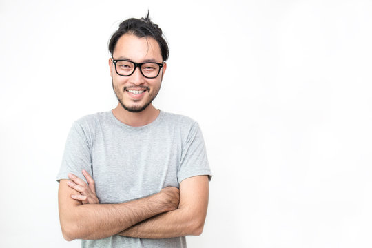 Attractive beautiful smiling positive nerd man - close up portrait asian beard nerdy man with crossed arms isolated on white background.