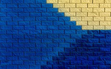 dark blue, blue and yellow bricks wall