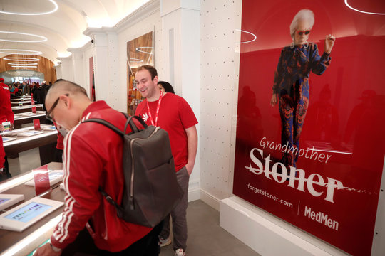 People look at products inside MedMen, a California-based cannabis company store serving medical prescription patients with cannabis products, on the store's opening day on 5th Avenue in Manhattan