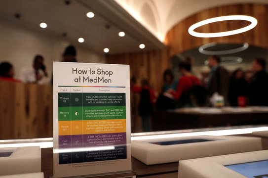 A notice board is seen near customers waiting to purchase products inside MedMen, a California-based cannabis company store serving medical prescription patients with cannabis products, in Manhattan in New York City