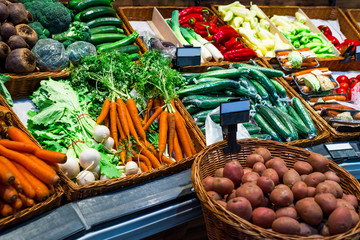 the layout in the store with fresh vegetables