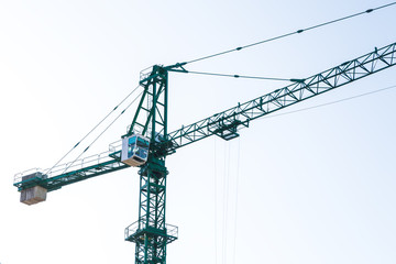 green construction crane, close-up photo, background image