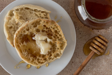 English muffin drizzled with honey