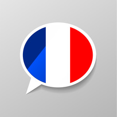 Bright glossy sticker in speech bubble shape with france flag, french language concept