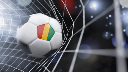 Realistic soccer ball in the net with the flag of Guinea.(series)