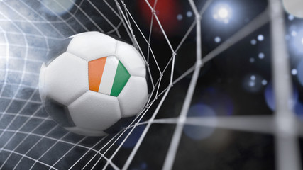 Realistic soccer ball in the net with the flag of Ivory Coast.(series)