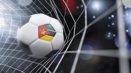 Realistic soccer ball in the net with the flag of Mozambique.(series)