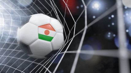 Realistic soccer ball in the net with the flag of Niger.(series)