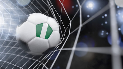 Realistic soccer ball in the net with the flag of Nigeria.(series)