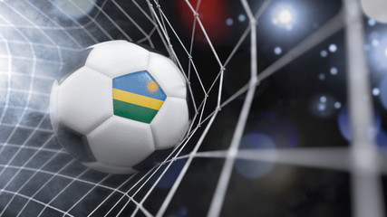Realistic soccer ball in the net with the flag of Rwanda.(series)