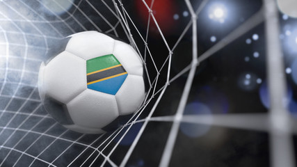 Realistic soccer ball in the net with the flag of Tanzania.(series)
