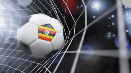 Realistic soccer ball in the net with the flag of Uganda.(series)