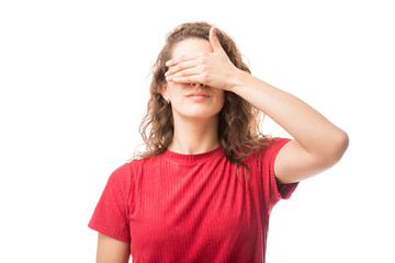 Young brunette covering her eyes