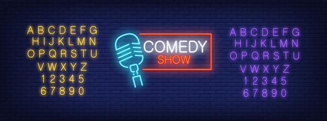 Neon alphabet and Comedy Show lettering with mike in frame on brick background. Show, nightclub, comedy club. Advertisement concept. For signboards, template design, banners