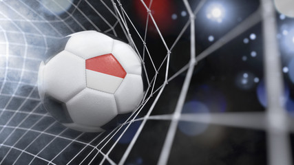 Realistic soccer ball in the net with the flag of Indonesia.(series)