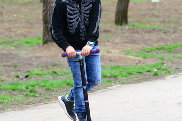 A child is riding a scooter in the park