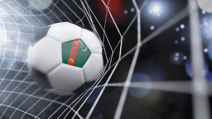 Realistic soccer ball in the net with the flag of Turkmenistan.(series)