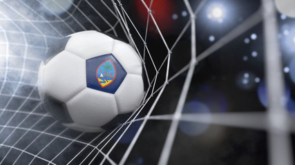 Realistic soccer ball in the net with the flag of Guam.(series)