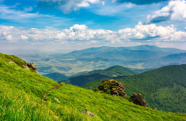beautiful mountain landscape with grassy hills. blue sky with fluffy clouds. foot path uphill