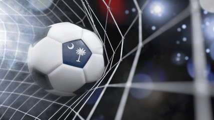 Realistic soccer ball in the net with the flag of South Carolina.(series)