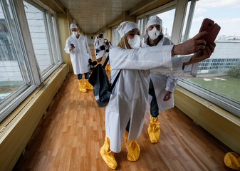Journalists take a selfie in a corridor of stopped third reactor at the Chernobyl nuclear power plant in Chernobyl