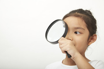 asian child girl with a magnifying glass