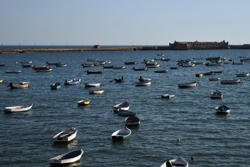 Boats off the Atlantic coast near the fortress of San Sebastian in Cadiz.
