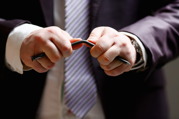 Man in suit and tie bend nail with arms closeup