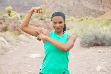 Strong, healthy African American woman working out in desert