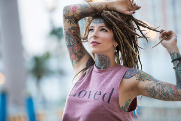 Beautiful hippie girl with tattoos and dreadlocks