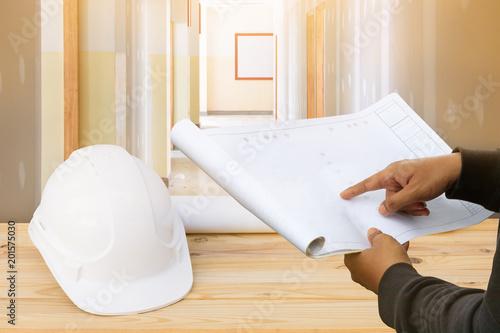 Engineer finger point on paper plan blueprint in check building engineer finger point on paper plan blueprint in check building technician place construction site gypsum board malvernweather Images