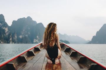 Beautiful woman posing on a boat