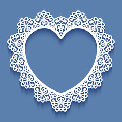 Laser cut paper lace frame in the shape of heart, vector illustration. Ornamental cutout photo frame with pattern. Abstract vintage background. Element for wedding invitation and greeting card.