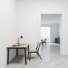 White home office interior, door, side view