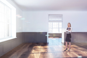 Real estate agent in an empty room