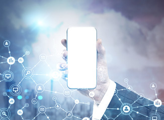 Hand with mock up smartphone screen, network